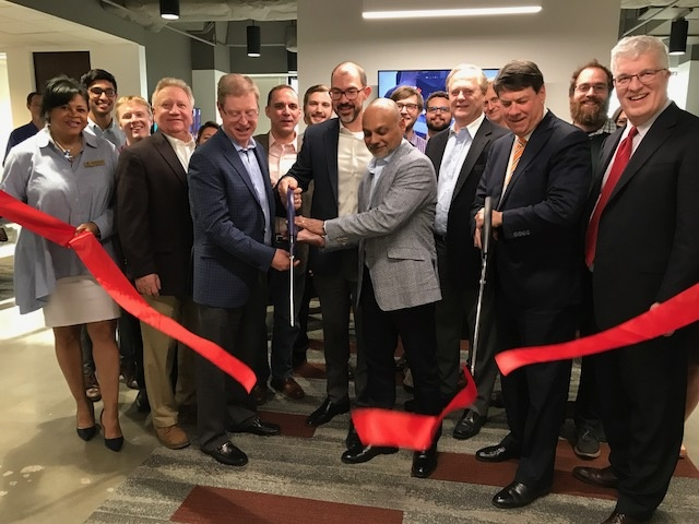 City of Sandy Springs representatives and officers of the Sandy Springs Perimeter Chamber join Axis President and Mayor Rusty Paul in the Ribbon Cutting ceremony at  the recent Axis Group opening.